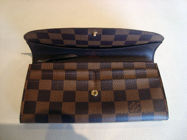 Louis Vuitton Portefeuille Emilie occasion, en vente Ile Saint Louis - Paris 0174fa456fa