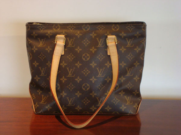 f9e39ed4af4 Cabas Piano Louis Vuitton occasion Sac en toile monogram. Fermeture ...