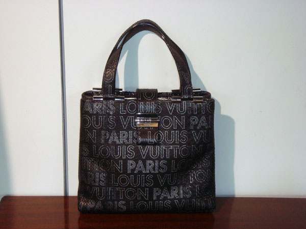Louis Vuitton Sac en python  occasion, en vente Ile Saint Louis - Paris
